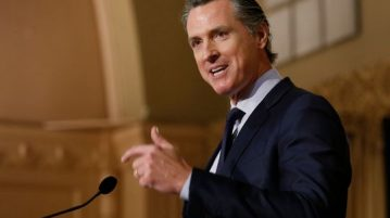 In this Jan. 17, 2019 file photo, Gov. Gavin Newsom speaks at the California Legislative Black Caucus Martin Luther King Jr., Breakfast, in Sacramento, California. Newsom is withdrawing several hundred National Guard troops from the nation's southern border and changing their mission.
