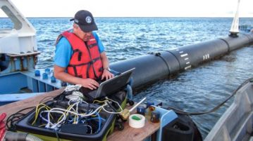 Steven Bink, the head of IT for the Ocean Cleanup, in Hawaii retrieving monitoring and test data from the system's sensors.