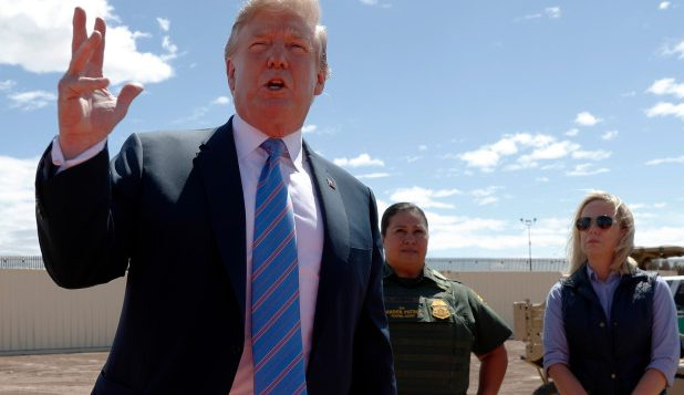 Donald Trump speaks as he visits a new section of the border wall with Mexico in Calexico, Calif.