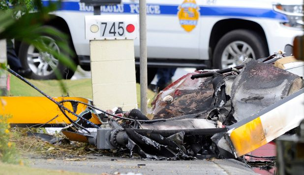 The wreckage of a helicopter lies on the street after crashing in Kailua, Hawaii.