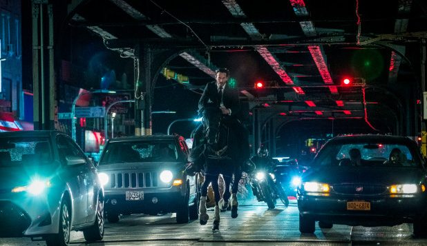 "Keanu Reeves as John Wick takes an unconventional mode of transportation in ""John Wick 3"" through the streets of New York City."